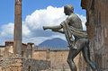 Apollo and mount vesuvius ancient roman bronze statue of in the ruined town of pompei with the volcano italy in the background Royalty Free Stock Photos