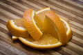 Appetising juicy orange slices lie on a wooden board Royalty Free Stock Image