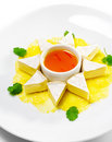 Appetizer - Camembert on a Pineapple Carpaccio Royalty Free Stock Image