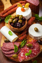Appetizer catering platter with different meat and cheese products Royalty Free Stock Images