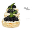 Appetizer with caviar close up on white background Royalty Free Stock Images