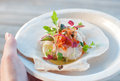 Appetizer ceviche with raw scallop and sauce Royalty Free Stock Images