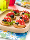 Appetizer cracker with cheese and tomato for summer party selective focus Royalty Free Stock Photo