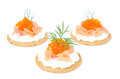 Appetizer crackers with cream cheese salted salmon red caviar and on white background Stock Photos