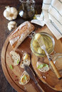 Appetizer: garlic confit in jar and franch spread bread Royalty Free Stock Photo