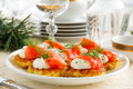 Appetizer of hash browns and red fish Stock Photo