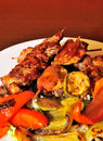 Appetizer meat kebab with vegetables Stock Image