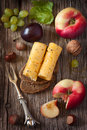 Appetizer picnic nosh delicious cheese on a rye bread with fruit and nuts on a wooden board Royalty Free Stock Images