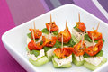 Appetizer plate of small feta cucumber and tomato appetizers on toothpicks Royalty Free Stock Images