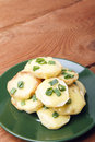 Appetizer of potatoes, cheese and green onions. There is room for text Royalty Free Stock Photo