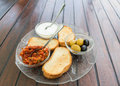 Appetizer turkish traditional served on plate yogurt olives bread and vegetables mixed salad Royalty Free Stock Photo