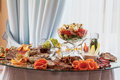 Appetizers at banquet table appetizing food snacks decorated Stock Images