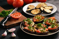 Appetizers- grilled eggplants with tomatoes, garlic and dill. Royalty Free Stock Photo