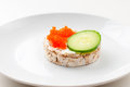 Appetizers with red fish herbs cucumber and red caviar on a white plate close up Stock Photography
