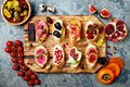 Appetizers table with italian antipasti snacks. Brushetta or authentic traditional spanish tapas set Royalty Free Stock Photo