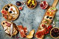 Appetizers table with italian antipasti snacks. Brushetta or authentic traditional spanish tapas set, cheese variety board Royalty Free Stock Photo