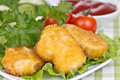 Appetizing chicken nuggets with lettuce leaves Stock Photo