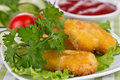 Appetizing chicken nuggets with lettuce leaves Stock Images