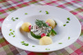Appetizing dish in culinary art on checkerd table cloth Royalty Free Stock Photos