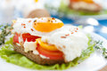 Appetizing and flavorful fried eggs with vegetables Royalty Free Stock Photos