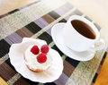 Appetizing fruitcake with cream and raspberry Stock Images