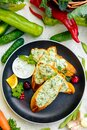 Appetizing garlic bread with cheese and fresh vegetables Royalty Free Stock Photo