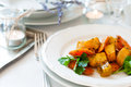 Appetizing and healthy vegetarian food baked pumpkin carrot with herbs on a white plate a beautiful table setting close up Royalty Free Stock Photos