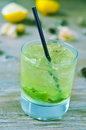 Appetizing mojito a glass with an on a rustic wooden table outdoors Royalty Free Stock Image