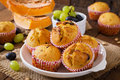 Appetizing and ruddy muffins with pumpkin grapes Royalty Free Stock Photos