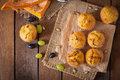Appetizing and ruddy muffins with pumpkin grapes Stock Image