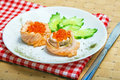 Appetizing of salmon fish with red caviar Stock Photography