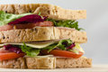 Appetizing sandwich bread tomatoes lettuce and ham. Close up Royalty Free Stock Photo