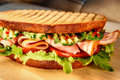 Appetizing sandwich with ham tomato cucumber salad. Royalty Free Stock Photo