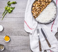Appetizing turkey with onions and rice spread out on half the pan on a white napkin knife and fork with spices and herbs on g Royalty Free Stock Photo