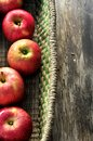 Apple in artisan basket case recipient for cooking a eating fresh fruit Royalty Free Stock Images