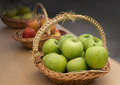 Apple baskets of different kinds of fresh apples on the table Stock Images