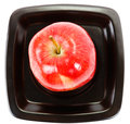 Apple on a black plate red top view Stock Image