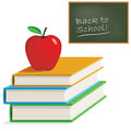 Apple on books with chalkboard Royalty Free Stock Photography