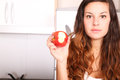Apple byte a young adult woman with fruits and wine in the kitchen Royalty Free Stock Photos