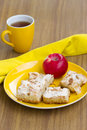 Apple cakes with tea cup and red Stock Images
