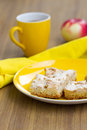 Apple cakes with tea cup and red Royalty Free Stock Images