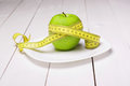 Apple with centimeter on the plate healthy eating eat Royalty Free Stock Photography