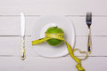 Apple and centimeter on the plate sport healthy food love Stock Image