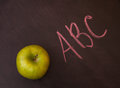 Apple on the chalkboard classroom with Royalty Free Stock Photography