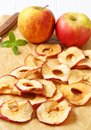 Apple chips on baking parchment paper Stock Photos