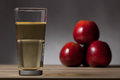 Apple cider with three red apples Stock Photo