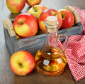 Apple cider vinegar on a brown table Royalty Free Stock Image