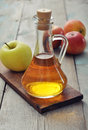 Apple cider vinegar in glass bottle and fresh apples Stock Photography