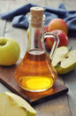 Apple cider vinegar in glass bottle and fresh apples Royalty Free Stock Photo