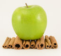 Apple cinnamon granny smith on sticks Stock Photos